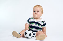 Cute Baby with soccer ball Royalty Free Stock Photos