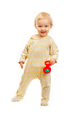 Cute baby standing with rattle on white background Stock Photography