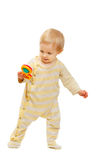 Cute baby standing with rattle on white background Royalty Free Stock Photos