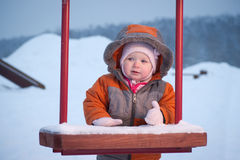 Cute baby stay and hold kids swing Royalty Free Stock Image