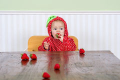 Cute baby in strawberry suit Royalty Free Stock Images