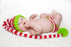 Cute Baby in Striped Knit Hat. Baby wearing red white and green striped knit hat and diaper cover Stock Photos