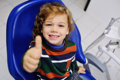Cute baby in a striped sweater on reception at the dentist Stock Photo