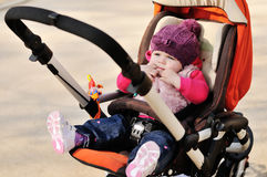 Cute baby in stroller Royalty Free Stock Image