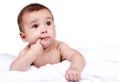 Cute baby sucking his finger Stock Images