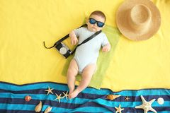 Cute baby in sunglasses lying Royalty Free Stock Photos