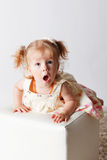 Cute baby with a surprised face expression Stock Photo