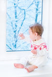Cute baby in sweater with Christmas ornament Royalty Free Stock Photos