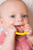 Cute baby with a teething ring Stock Image