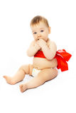 Cute baby tied up with a red ribbon Stock Photos