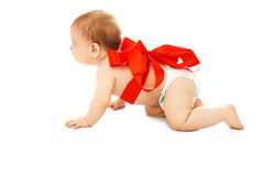 Cute baby tied up with a red ribbon Royalty Free Stock Image