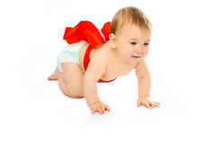 Cute baby tied up with a red ribbon Royalty Free Stock Photography