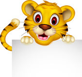 Cute baby tiger posing with sign Royalty Free Stock Image