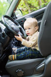Cute baby  toddler boy in a car Stock Photo