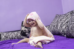 Cute baby and a towel Stock Image