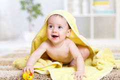 Cute baby with a towel after the shower at home Royalty Free Stock Images