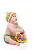 Cute baby with a toy Stock Images