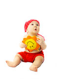 Cute baby with a toy Sun dreaming of summer Royalty Free Stock Image