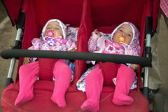 Cute baby twins in double stroller Stock Photography