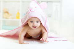 Cute baby under the towel after bathing at home Royalty Free Stock Photo