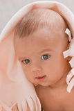 Cute baby under a white blanket Royalty Free Stock Images