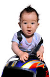 Cute baby  uses motorcycle helmet Stock Photography