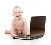 Cute baby using a laptop Stock Image