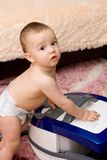 Cute baby with vacuum cleaner Stock Photography