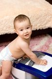 Cute baby with vacuum cleaner Royalty Free Stock Image
