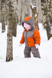Cute baby walk in winter park Stock Image