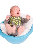 Cute baby in washbasin on white background Royalty Free Stock Images