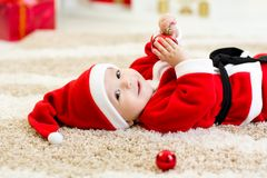 Cute Baby weared Christmas clothes Stock Images