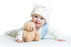 Cute baby weared funny hat with plush toy stock photography