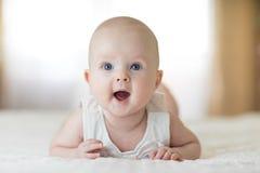 Cute baby wearing lying on tummy in nursery room royalty free stock image