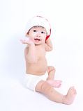 Cute baby wearing santa hat. Stock Photography