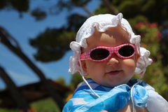 Cute baby wearing sunglasses Stock Images