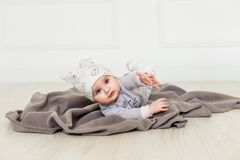 Cute baby on white background.Close up head shot of a caucasian baby girl, six months old baby in a grey clothes and royalty free stock photography