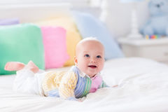 Cute baby on white bed Royalty Free Stock Photos