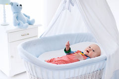 Cute baby in white nursery Stock Photography