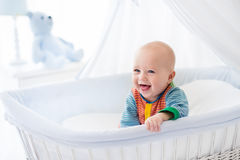 Cute baby in white nursery Royalty Free Stock Photos