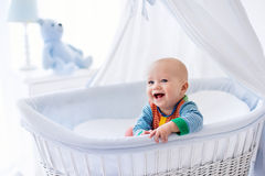 Cute baby in white nursery Royalty Free Stock Photo