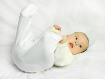 Cute baby on the white sofa Stock Image