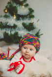 The cute baby whith x-mas tree Royalty Free Stock Image