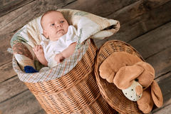 Cute baby in willow basket. stock photography