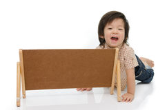 Cute baby with a woodboard Stock Photos