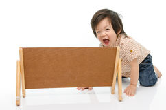 Cute baby with a woodboard Stock Image