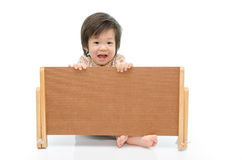 Cute baby with a woodboard Stock Photo