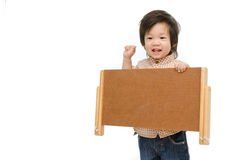Cute baby with a woodboard Royalty Free Stock Photo