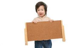 Cute baby with a woodboard Royalty Free Stock Photos