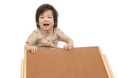 Cute baby with a woodboard Royalty Free Stock Images